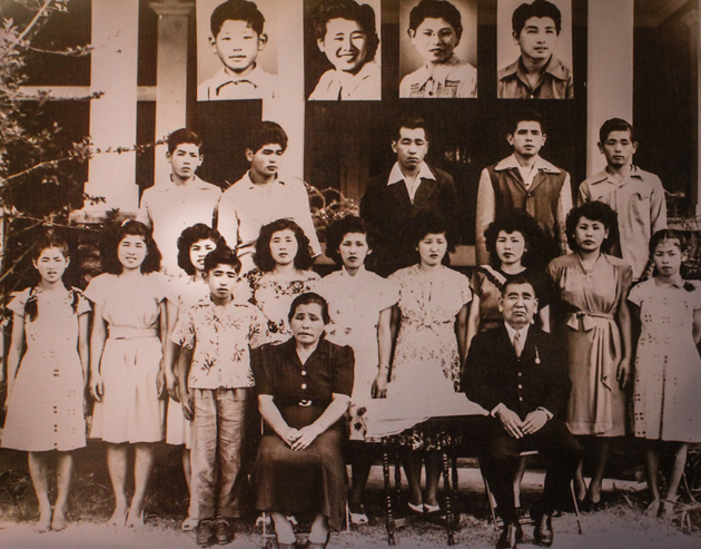 An Okamoto family portrait when Lillian was 12. She is the third from the left in the row of girls.