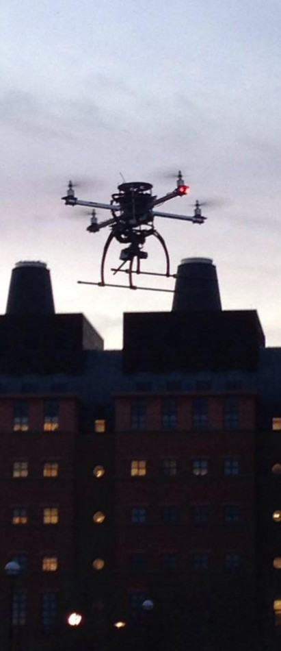 A quadrotor soars above the University of CIncinnati campus.
