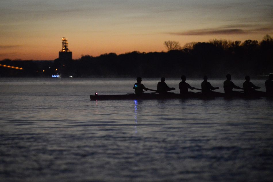 The UC club rowing team hits the water as early as 5 a.m. for practice.